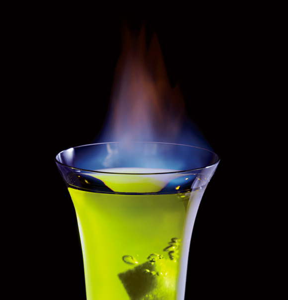 Flaming the absinthe is a delightful tradition in my home. It brings out my inner pyromaniac and it scares the children into silence. Pour absinthe over a sugar cube balanced on a slotted spoon (or fork). Light the sugar cube. The flames will eventually ignite the contents in the glass as well. When you've tired of this, pour iced water to douse the flames. Drink deeply. Try not to cut off your ear afterwards.